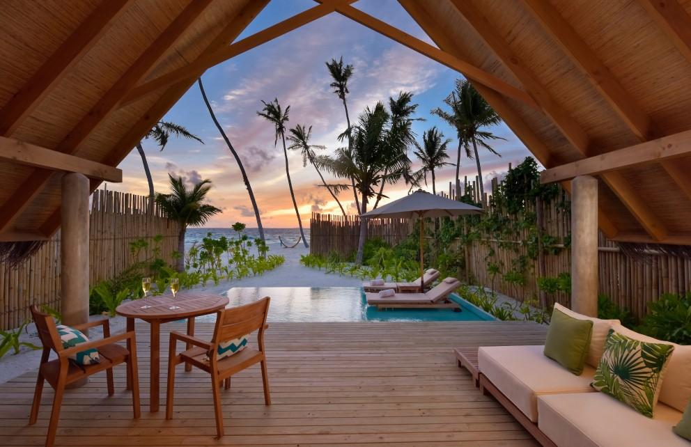 pool beach villa at fushifaru maldives facing the ocean