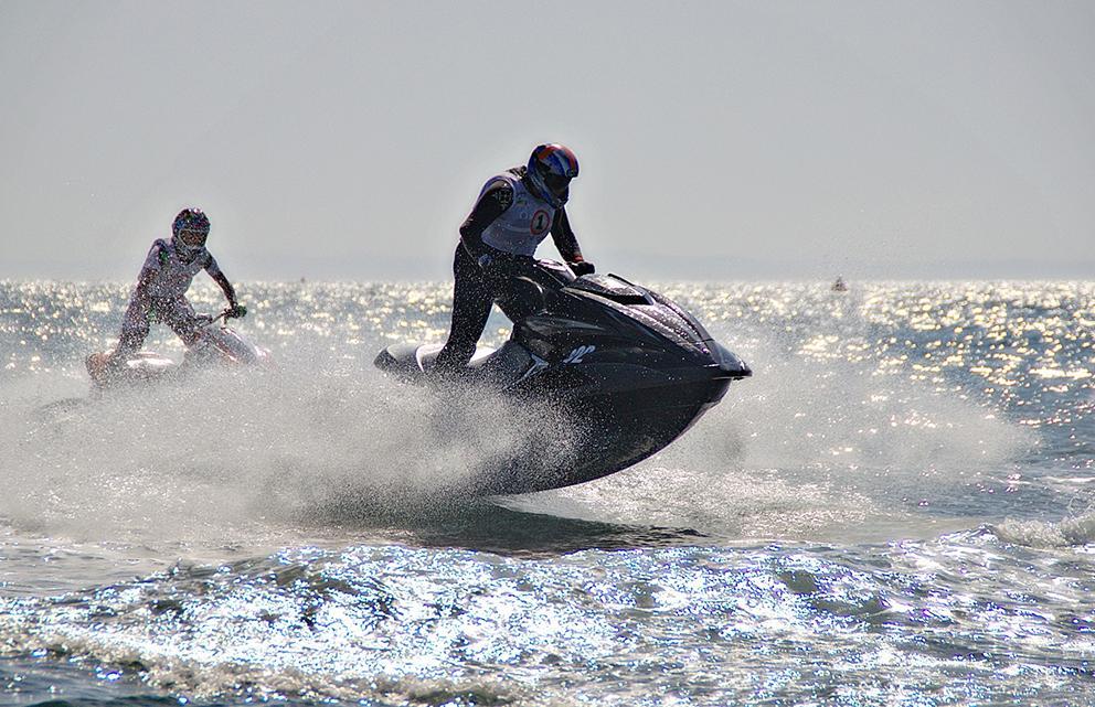 people riding jet ski